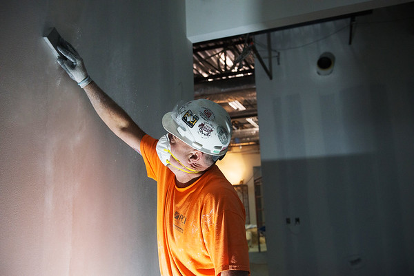 Chawn Gibson, with PCI, works inside the new Jasper County Juvenile Justice Center on Monday.<br /> Globe | Roger Nomer