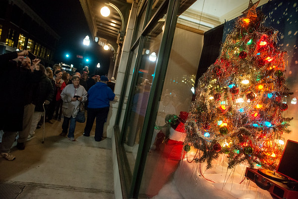 Christmas-themed windows are unveiled on Tuesday evening at Joplin City Hall.<br /> Globe   Roger Nomer