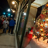 Christmas-themed windows are unveiled on Tuesday evening at Joplin City Hall.<br /> Globe | Roger Nomer
