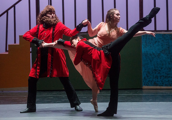 (from left) Darrick Green, as the Beast, David Scheuerman, as the Prince, and Kim Sager, as Beauty, rehearse a scene from Beauty and the Beast on Wednesday at Pittsburg's Memorial Hall.<br /> Globe | Roger Nomer