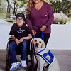 "Aimee Albiar and her 12-year-old son Xavier pose with Xavier's service dog, ""Kali,"" who was trained as a Canine Companion dog by the mother/daughter duo of Mary Green and Kyna Adams. The pair are currently working on training their third service dog.<br /> Courtesy Photo"