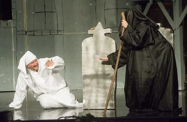 """Karl Wendt, as Scrooge, and Teresa Welch, as the Ghost of Christmas Yet to Be, rehearse a scene from """"A Christmas Carol"""" on Monday at Ozark Christian College.<br /> Globe 