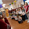 Joplin High football players pose for photos with Kelsey Norman third graders on Friday.<br /> Globe   Roger Nomer