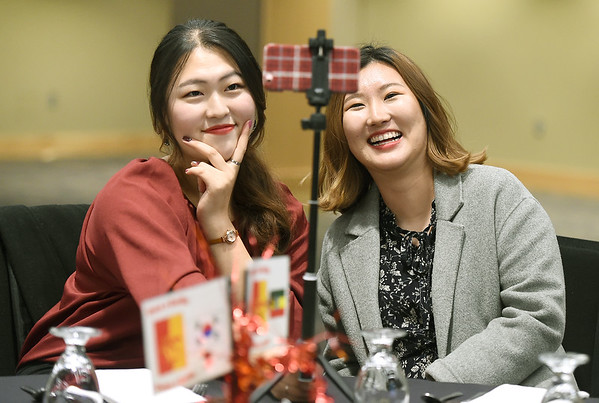 From the left: Pittsburg State international students Surin Jei and Jisu Choe, both of South Korea, pose for a selfie during PSU's end of semester banquet for international students on Thursday night at PSU.<br /> Globe   Laurie Sisk