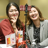 From the left: Pittsburg State international students Surin Jei and Jisu Choe, both of South Korea, pose for a selfie during PSU's end of semester banquet for international students on Thursday night at PSU.<br /> Globe | Laurie Sisk