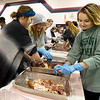 Kaylea Fergerson, left and Bridgett Brennecke, right join 50 other Missouri Southern Zeta Tau Alpha sorority sisters for Thanksgiving prep help on Thursday night at the Salvation Army. The Salvation Army expects to feed 400 to 500 guests on Thanksgiving Day.<br /> Thanksgiving Day.<br /> Globe | Laurie Sisk