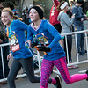 Twins Olivia, left, and Addison Teeter, 12, finish arm in arm during Thursday's Turkey Trot 5K in downtown Joplin.<br /> Globe | Roger Nomer