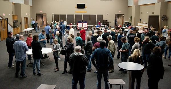 Voters wait in line at St. Paul's United Methodist Church on Tuesday afternoon.<br /> Globe | Roger Nomer
