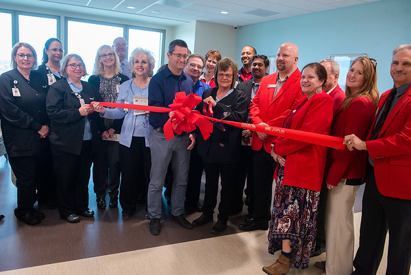Shari Dugan, manager of Behavorial Health at Mercy Hospital Joplin, cuts the ribbon for the new Mercy Hospital Joplin Behavorial Health Unit on Tuesday.<br /> Globe   Roger Nomer