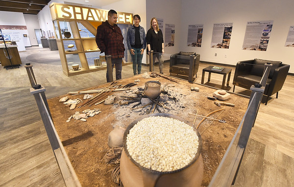 The staff of the new Shawnee Tribe Cultural Center stand by a display on Friday. From the left: Kenny Glass,  Store and Visitors Services, Natalie Wadle, Exhibits and Programs and Marnie Leist, center director. The center is scheduled to open today in Miami.<br /> Globe | Laurie SIsk
