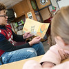 Isaiah Davis, a Joplin High junior, reads to third graders at Kelsey Norman Elementary on Friday.<br /> Globe | Roger Nomer