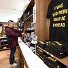 Shawnee Tribe Cultural Center Store Manager Kenny Glass organizes shirts inside the center's store on Friday. The center is scheduled to open today in Miami.<br /> Globe | Laurie SIsk