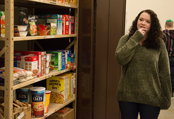 Stephanie Shaw, a Missouri Southern senior from Carl Junction, gives a tour of the new Lion Co-Op food pantry on Tuesday. Globe | Roger Nomer