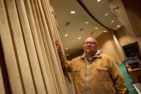Bryan Goodwin, Missouri Southern Physical Plant director, talks about replacing acoustic curtains in Taylor Auditorium on Monday.<br /> Globe | Roger Nomer
