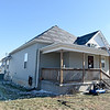 A crew from Mayberry Roofing helps install new roofing donated by Tamko on a house in South Joplin on Tuesday.<br /> Globe   Laurie Sisk