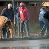 Workers smooth concrete for a foundation of a house being donated for St. Jude Hospital on Tuesday morning in Webb City.<br /> Globe | Roger Nomer