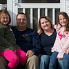 (from left) Halia, 7, Jeff, Stephanie and Alonna, 9, Baker pose for a photo on Saturday.<br /> Globe | Roger Nomer