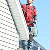 Austin Lamb, of Mayberry Roofing, helps install new roofing donated by Tamko on a house in South Joplin on Tuesday.<br /> Globe   Laurie Sisk