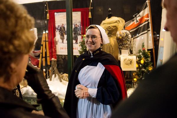 Emily Ellis portrays a World War I Red Cross nurse during Tuesday's unveiling of the City Hall windows in Joplin.<br /> Globe | Roger Nomer