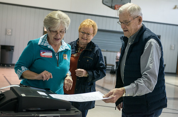 Sharon Patton, left, helps Lila Paugh and Charlie Slates with the ballot machine on Tuesday at the Church of the Nazarene in Carthage on Tuesday.<br /> Globe   Roger Nomer