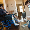 Service dog Mona demonstrates how she helps Alex Mikolasko with his socks as his mother Shelly watches on Monday at their Joplin home.<br /> Globe | Roger Nomer