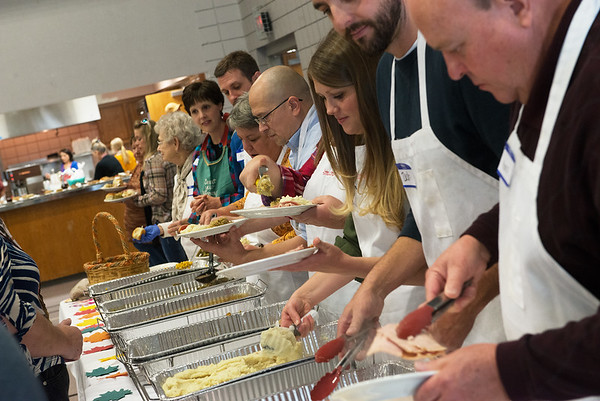 Volunteers serve a Thanksgiving meal at First United Methodist Church on Thursday.<br /> Globe | Roger Nomer