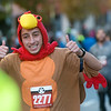 Philip Calcagna, Blue Springs, flashes a thumbs up as he crosses the finish line of the Turkey Trot 5K on Thursday in downtown Joplin.<br /> Globe | Roger Nomer