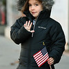 Four-year-old Cora Royster waves to the passing procession of bands, floats and other entries during the 31st Annual Veteran's Day Parade on Saturday morning in downtown Joplin.<br /> Globe   Laurie Sisk