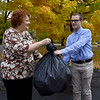 Thomas Jefferson student Preston Johnson, right, takes a bag of recyclables from neighbor Lana Nelson in his Tabor Woods neighborhood. His recycling began as a community service project at his school, but Johnson has continued the work on his own.<br /> Globe | Laurie Sisk