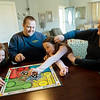 (from left) Halia, 7,  Jeff, Alonna, 9, and Stephanie Baker play a game on Saturday in Joplin.<br /> Globe | Roger Nomer