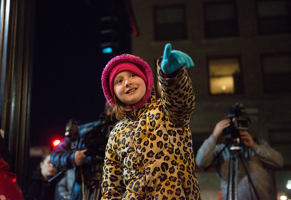 Jada Buck, 10, watches as the windows at Joplin City Hall are unveiled on Tuesday evening.<br /> Globe | Roger Nomer