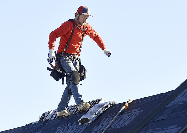 Milton Lamb, of Mayberry Roofing, helps install new roofing donated by Tamko on a house in South Joplin on Tuesday.<br /> Globe | Laurie Sisk