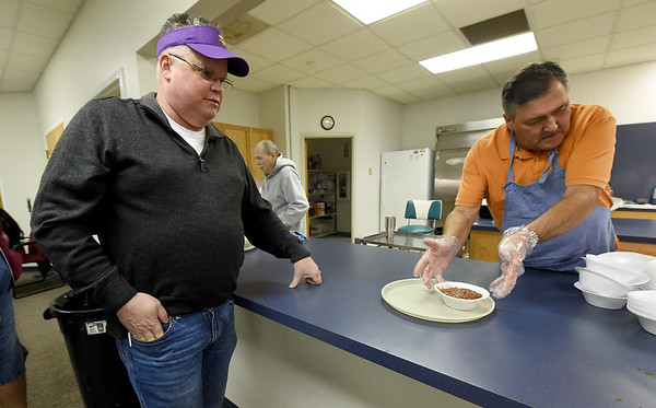 Volunteer Ed Mann, right, serves fresh chili to Tim Sievert during the Joplin Association for the Blind and the Low Vision Enhancement Center's Chili and Soup Feed on Thursday night at the JAB. The event featured a silent auction, a 50/50 drawing and free glaucoma screenings in the afternoon.<br /> Globe | Laurie Sisk