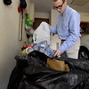 Thomas Jefferson student Preston Johnson sorts bags of recyclables in his Tabor Woods neighborhood. His recycling began as a community service project at his school, but Johnson has continued the work on his own.<br /> Globe | Laurie Sisk