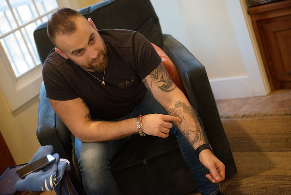 Domenico Rea talks about his tattoo of his grandmother Olimpia Rea, Kerry Sachetta's mother, during an interview on Wednesday in Joplin.<br /> Globe | Roger Nomer