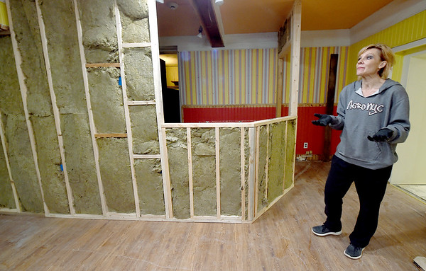 Stacia Eliott stands in what will soon be a lobby area inside the old Richardson's Candy House on Tuesday. Elliott plans to open a medical spa and other businesses inside the historic building, while keeping some artifacts from the candy house.<br /> Globe | Laurie Sisk