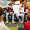 Garrett Landis, left, and Zechariah Stayton, both Joplin High juniors, read to third graders at Kelsey Norman on Friday.<br /> Globe | Roger Nomer