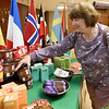 Shari Clanton browses the large selection of Equal Exchange fair trade coffees, teas and chocolates at the South Joplin Church's 7th Annual Alternative Christmas Fair on Friday. The sale continues today from 9 a.m. to 6 p.m. and Sunday from 12:30 p.m. to 2 p.m. at the church.Globe Globe | Laurie Sisk
