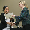 From the left: Kaya Solomon, from the Republic of St. Palau, smiles as she receives her International Knowledge and Experience certificate from Pittsburg State Study Abroad Coordinator Angela Moots during PSU's end of semester banquet for international students on Thursday night at PSU.<br /> Globe | Laurie Sisk