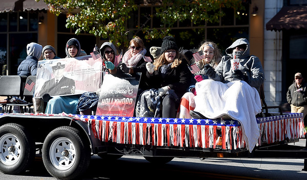 Members of the Joplin High School Show Choir sing patriotic songs during the 31st Annual Veteran's Day Parade on Saturday morning in downtown Joplin.<br /> Globe | Laurie Sisk