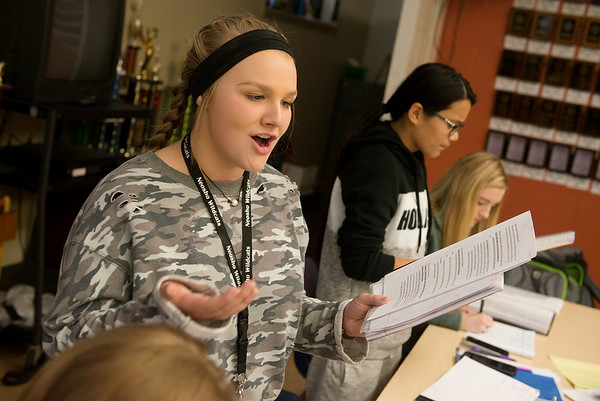 Amber Miller, sophomore, left, and Katy James, freshman, practice their debate skills on Tuesday at Neosho High School.<br /> Globe | Roger Nomer