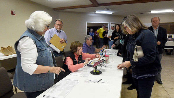Voters line up more than 30-deep for their chance to cast a ballot in the 2018 Midterm Election. Officials at the site reported a steady, strong turnout since the polls opened at 6 a.m.<br /> Globe | Laurie SIsk