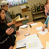 Neosho freshmen Rebecca Rodrigues and Nicholas Harris debate while Aaron Bayless, senior, judges on Tuesday at Neosho High School.<br /> Globe | Roger Nomer