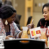 From the left: Fellow West Africans and Pittsburg State classmates Ulda Bangre (Burkina Faso) and Simret Guade (Ethiopia)  enjoy a laugh during PSU's end of semester banquet for international students on Thursday night at PSU.<br /> Globe | Laurie Sisk