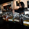 Holly Crane restocks candy in the lobby of Bookhouse Cinema, which she and her husband, Brad Carne opened earlier this year.<br /> Globe   Laurie Sisk