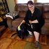 Mary Green poses with Declan III, a labrador retriver that she and her daughter Kyna Adams are training as a service dog through Canine Companions.<br /> Globe | Laurie SIsk