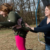 Stephanie Baker pushes her daughter Halia, 7, on a swing on Saturday in Joplin.<br /> Globe | Roger Nomer