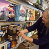 Susie Davidson arranges the local author section of Changing Hands Book Shoppe on Friday afternoon.<br /> Globe | Roger Nomer