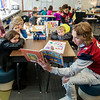 Zechariah Stayton, a Joplin High junior, reads to third graders at Kelsey Norman Elementary on Friday.<br /> Globe | Roger Nomer