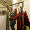 From the left: Crowder College students Brittany Ely and Ruth Fry replace a pulley system on a dog kennel door at the Faithful Friends animal shelter on Saturday in Neosho. About 60 volunteer students completed a variety of tasks Saturday at the shelter.<br /> Globe | Laurie SIsk
